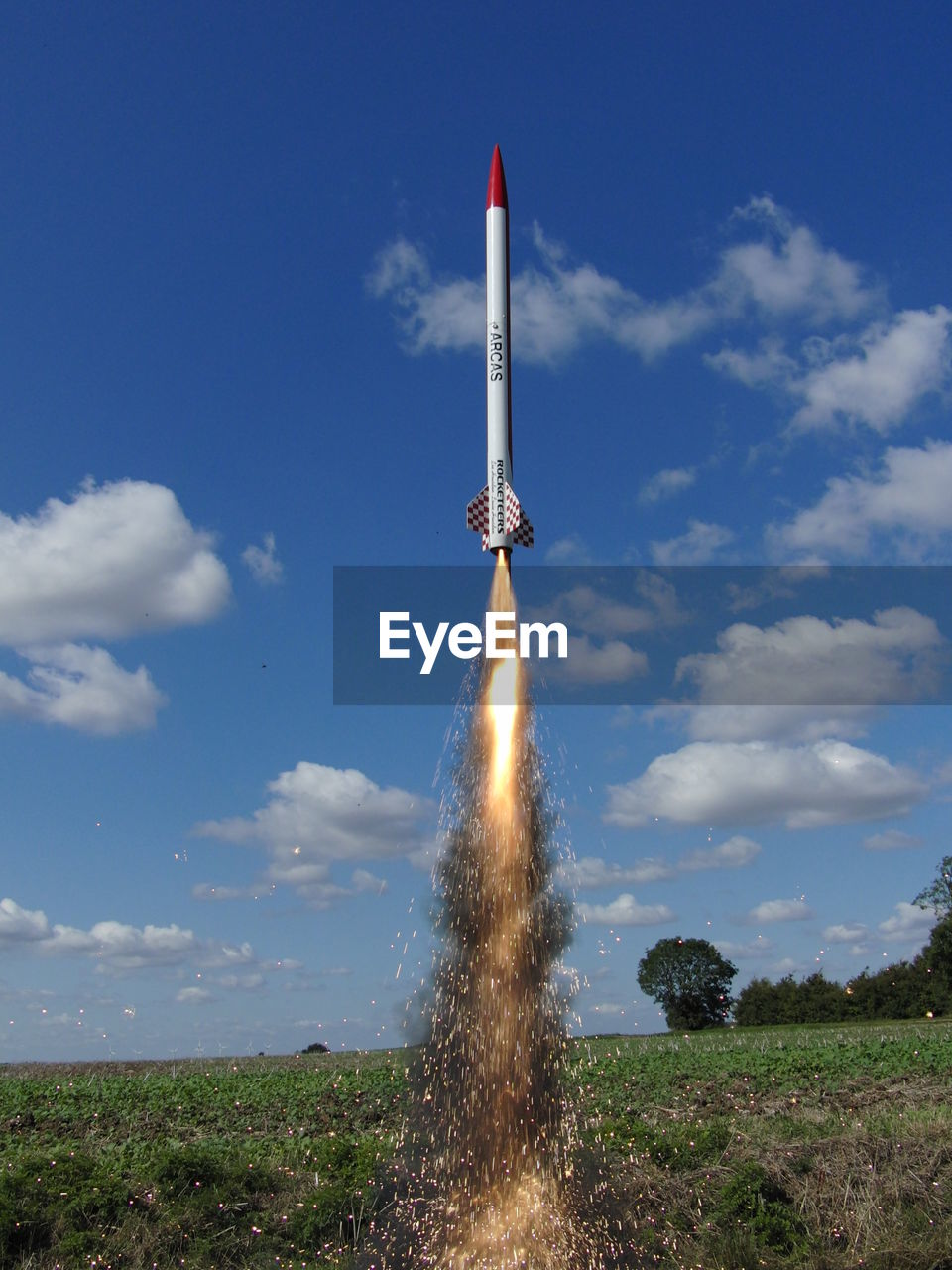 sky, cloud - sky, motion, exploding, field, outdoors, bomb, speed, day, no people, spraying, weapon, nature