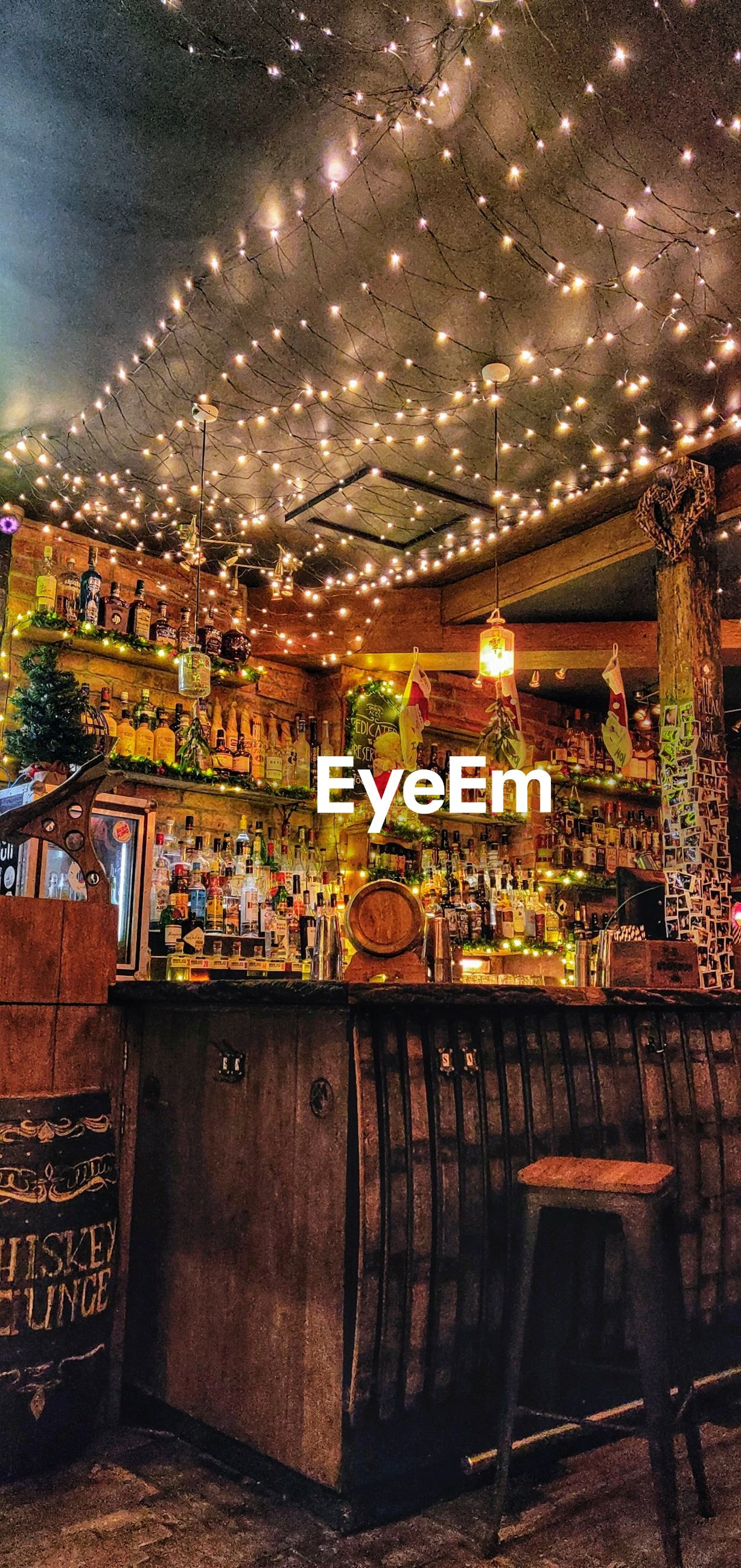 illuminated, food and drink, business, architecture, night, lighting equipment, retail, choice, decoration, built structure, container, variation, no people, large group of objects, food, abundance, store, market, collection, indoors, bar counter
