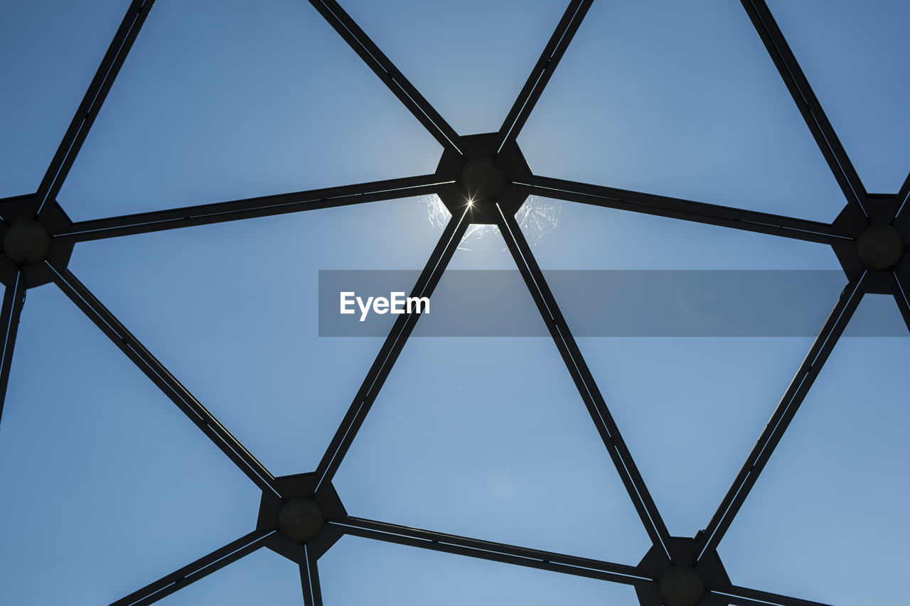 sky, low angle view, metal, pattern, clear sky, blue, no people, design, shape, day, architecture, geometric shape, nature, outdoors, built structure, close-up, full frame, connection, security