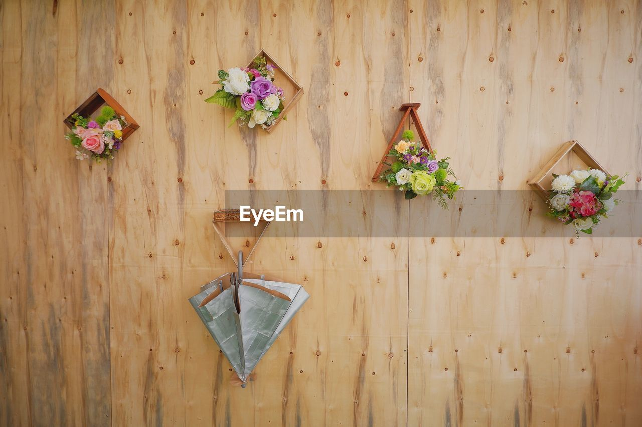 wood - material, flower, table, flowering plant, directly above, indoors, plant, no people, freshness, food and drink, wall - building feature, still life, pattern, food, nature, high angle view, creativity, decoration, day, close-up, floral pattern