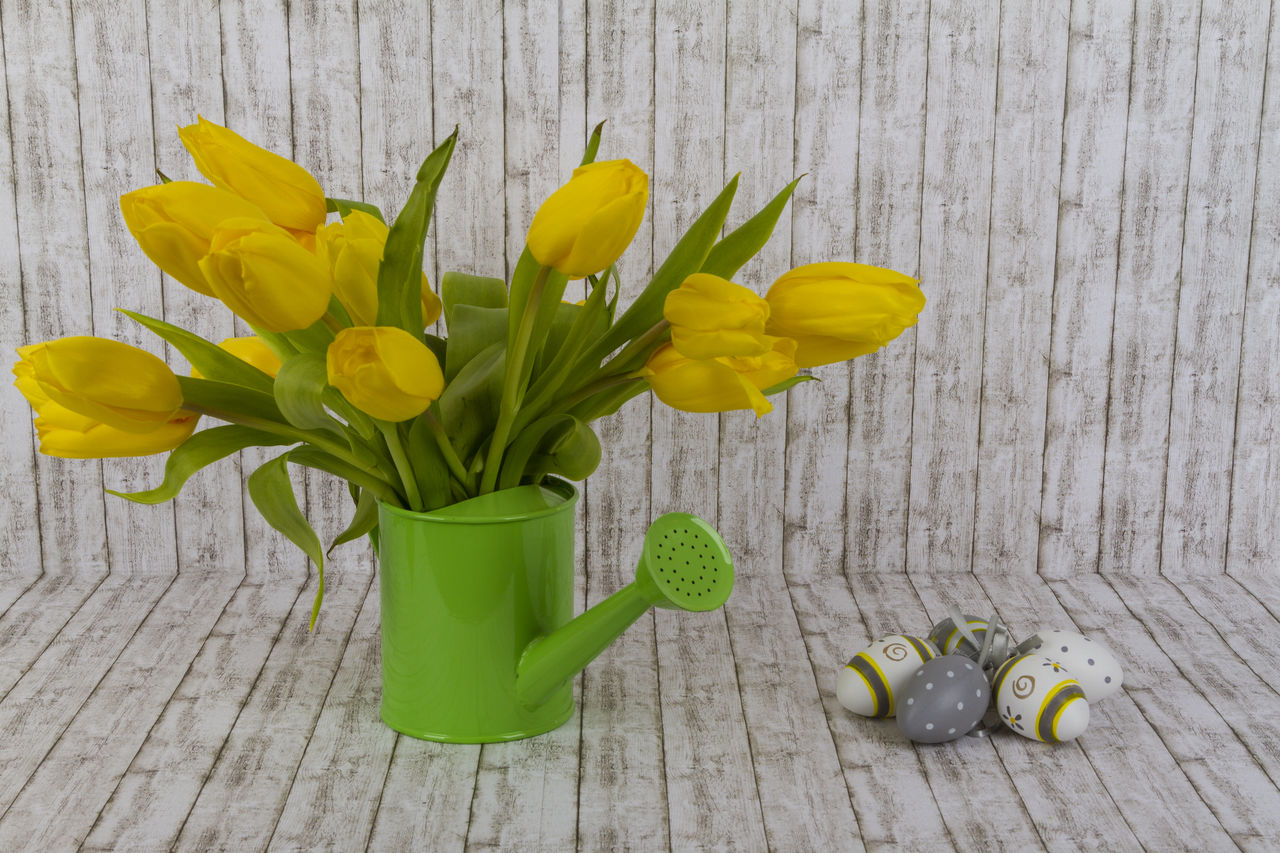 yellow, flower, flowering plant, wood - material, freshness, plant, beauty in nature, vase, tulip, petal, flower head, table, vulnerability, fragility, green color, indoors, nature, no people, close-up, inflorescence, flower arrangement, bouquet