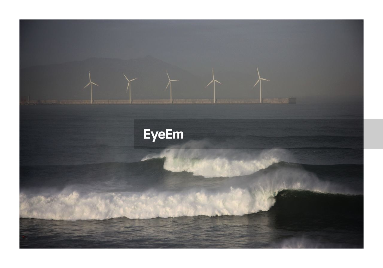 wind turbine, environmental conservation, renewable energy, turbine, alternative energy, wind power, environment, sea, water, sky, fuel and power generation, nature, beauty in nature, auto post production filter, motion, transfer print, no people, waterfront, power in nature, outdoors, sustainable resources