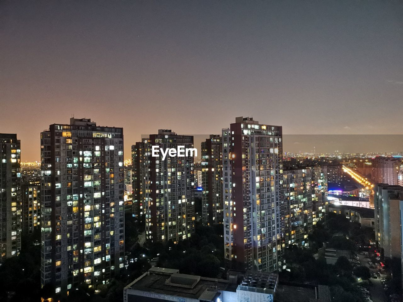 building exterior, architecture, built structure, city, illuminated, sky, building, cityscape, night, no people, nature, copy space, residential district, clear sky, high angle view, outdoors, office building exterior, skyscraper, apartment, settlement