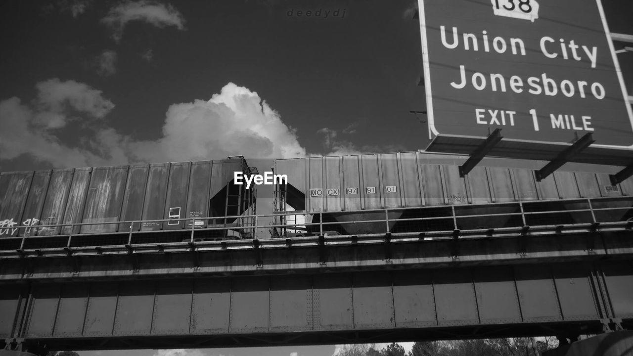 text, transportation, rail transportation, public transportation, communication, day, architecture, outdoors, no people, city, sky
