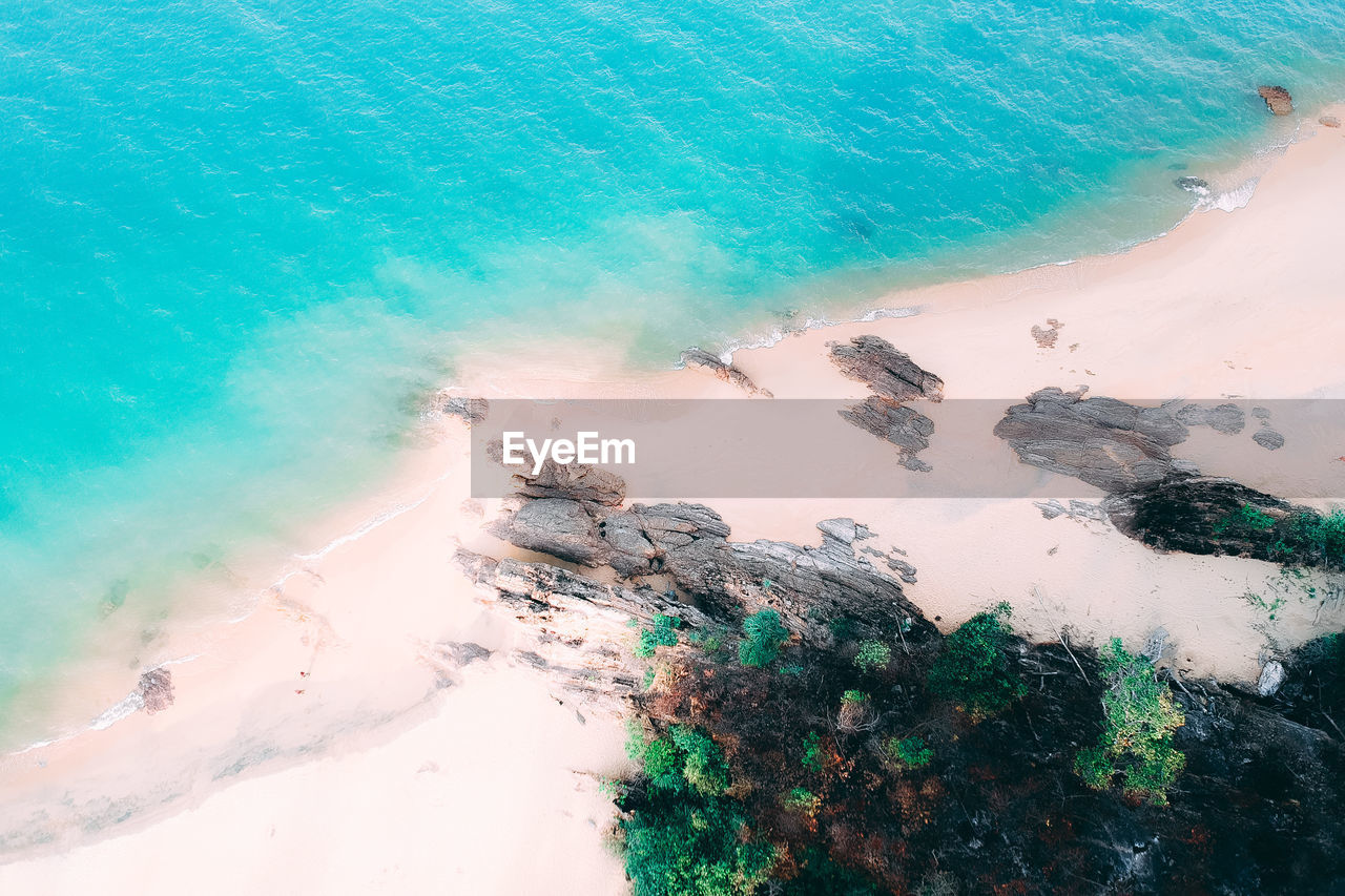 water, sea, land, beach, beauty in nature, nature, motion, day, high angle view, scenics - nature, no people, wave, outdoors, rock, tranquility, sport, idyllic, rock - object, aquatic sport, turquoise colored, power in nature