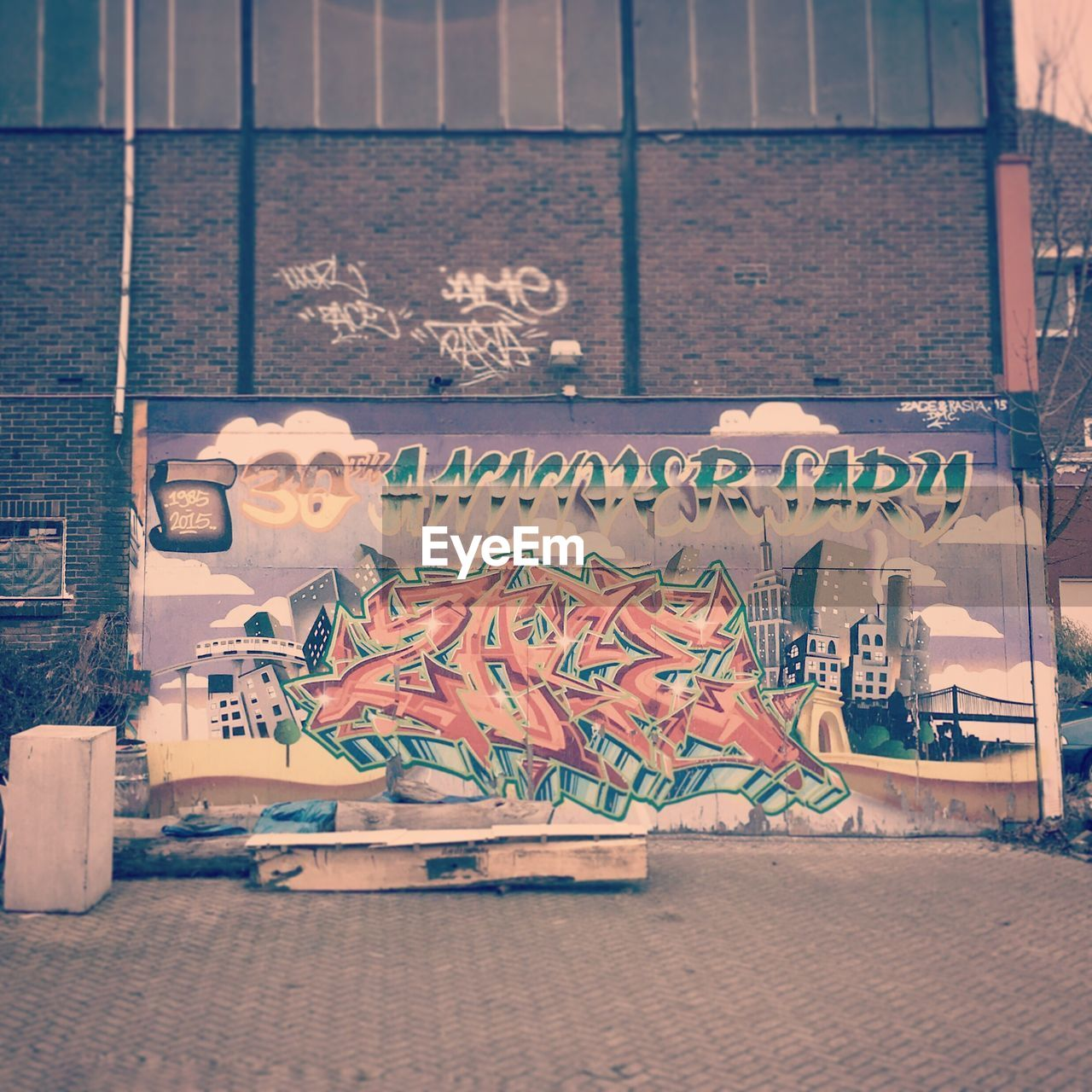 text, graffiti, art and craft, outdoors, human representation, building exterior, built structure, day, communication, architecture, no people, close-up