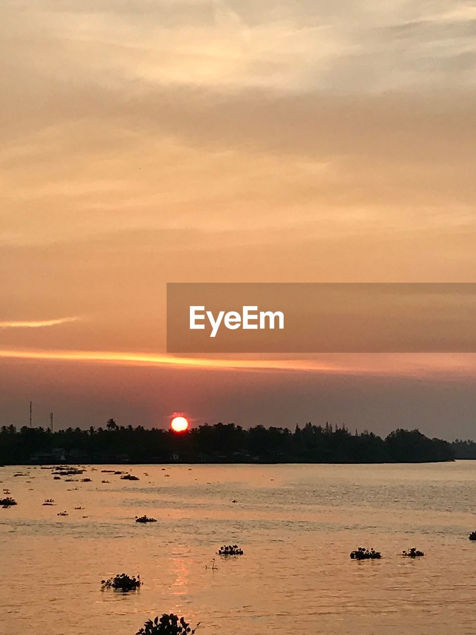 sunset, sky, beauty in nature, water, cloud - sky, scenics - nature, orange color, tranquil scene, nature, tranquility, no people, sun, idyllic, waterfront, non-urban scene, sea, outdoors, animal, remote