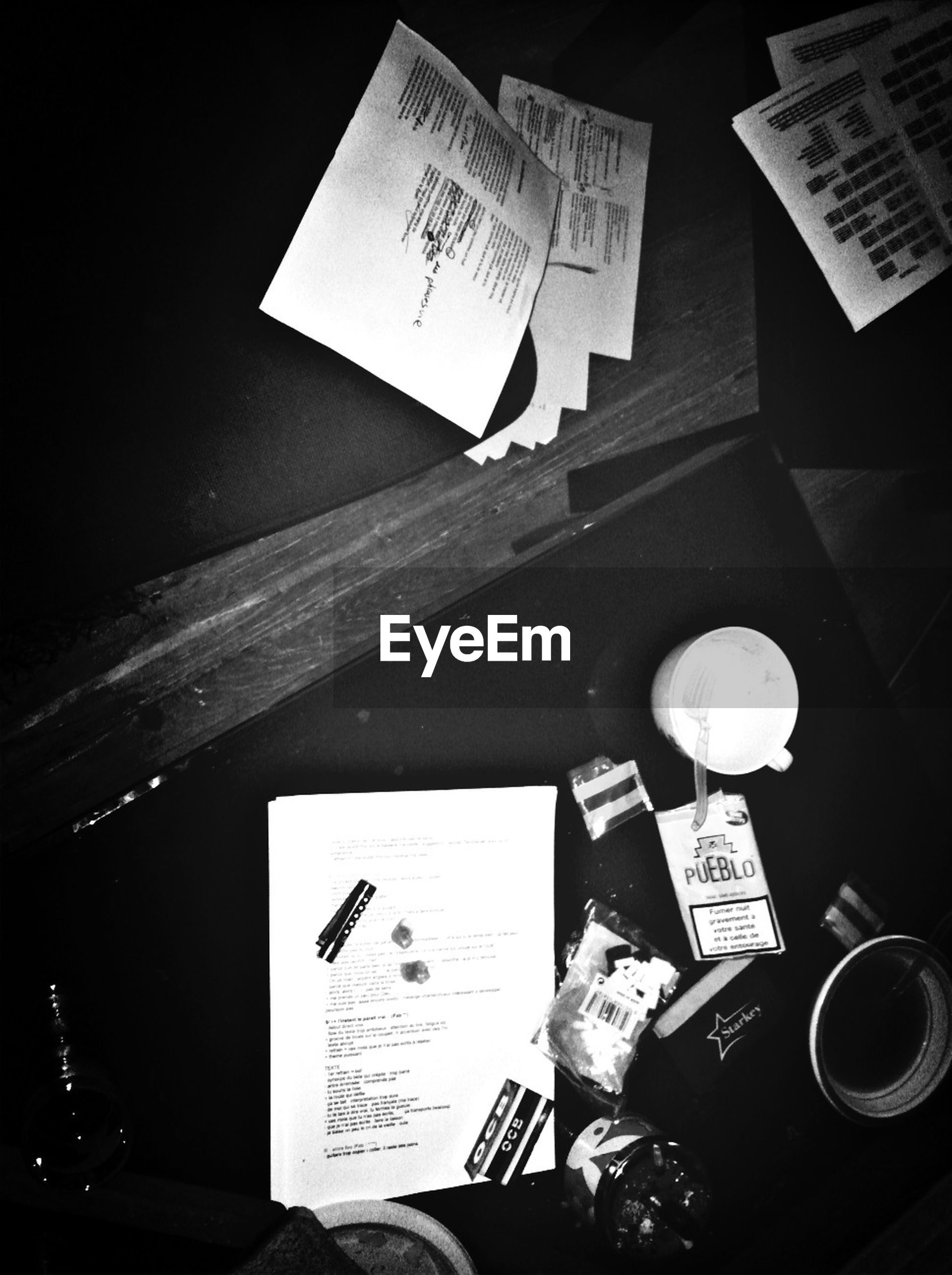 text, indoors, communication, western script, paper, book, table, still life, education, high angle view, close-up, drink, technology, no people, document, open, non-western script, information, handwriting, pen