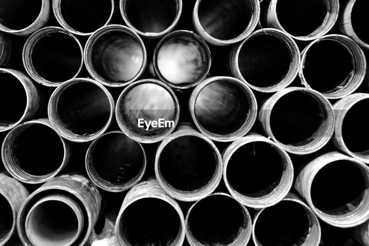 Full Frame Shot Of Stacked Pipes