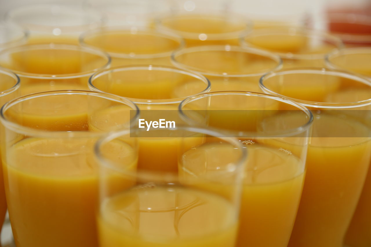 Close-up of orange juices served on table