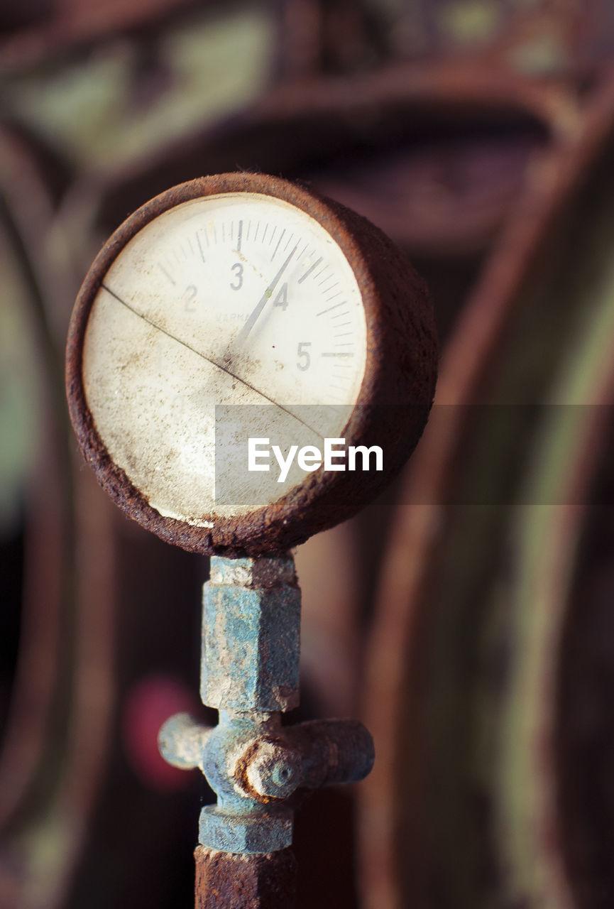 Close-up of rusty pressure gauge