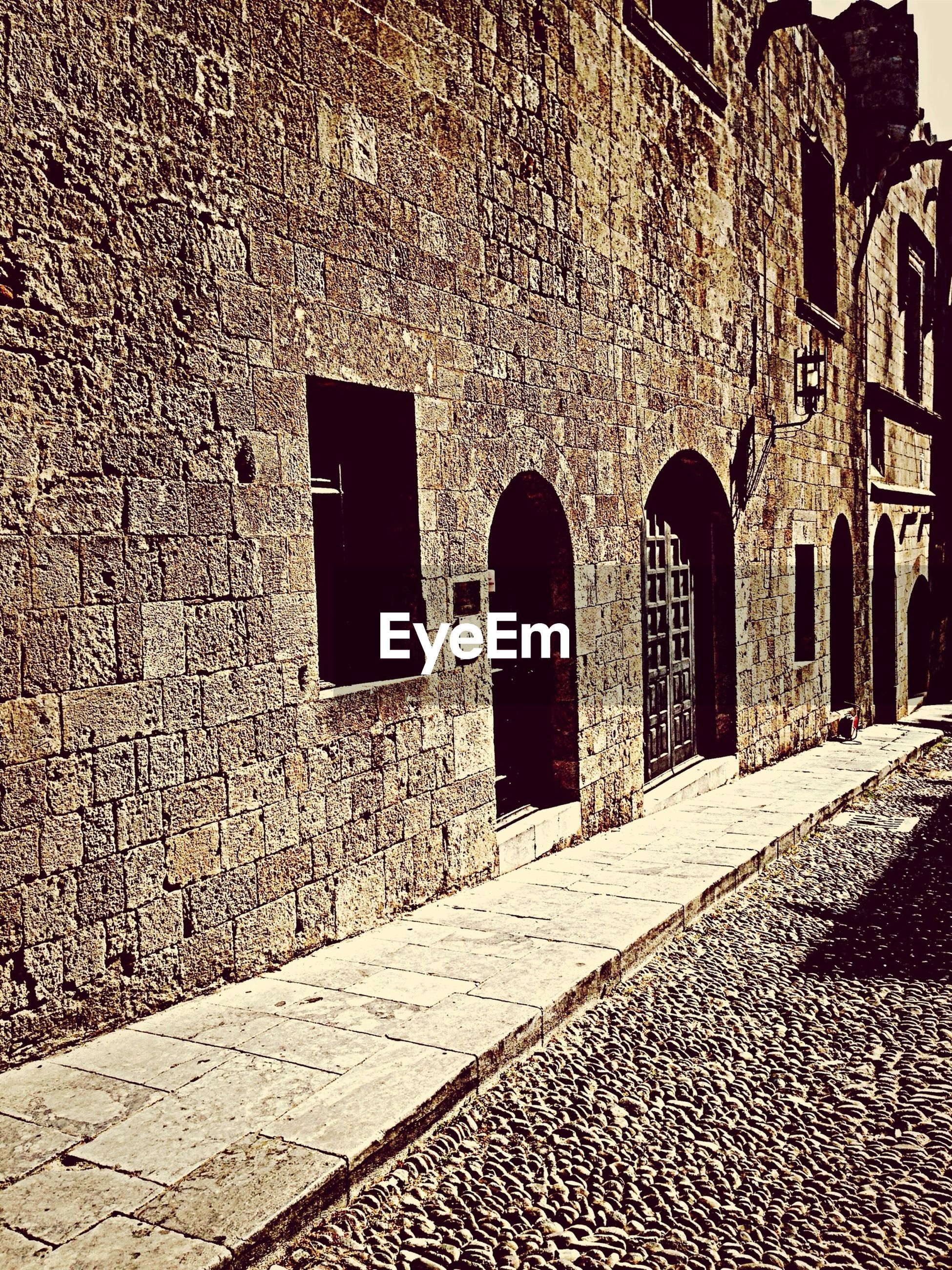 architecture, built structure, building exterior, arch, history, old, stone wall, cobblestone, the past, wall - building feature, brick wall, ancient, historic, building, day, stone material, no people, old ruin, outdoors, wall