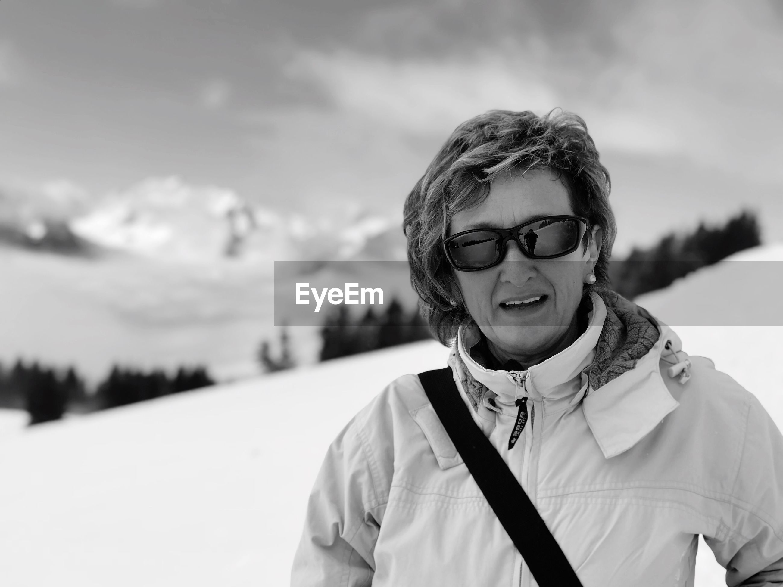 portrait, one person, smiling, winter, front view, leisure activity, happiness, real people, lifestyles, looking at camera, snow, cold temperature, clothing, glasses, focus on foreground, warm clothing, day, outdoors