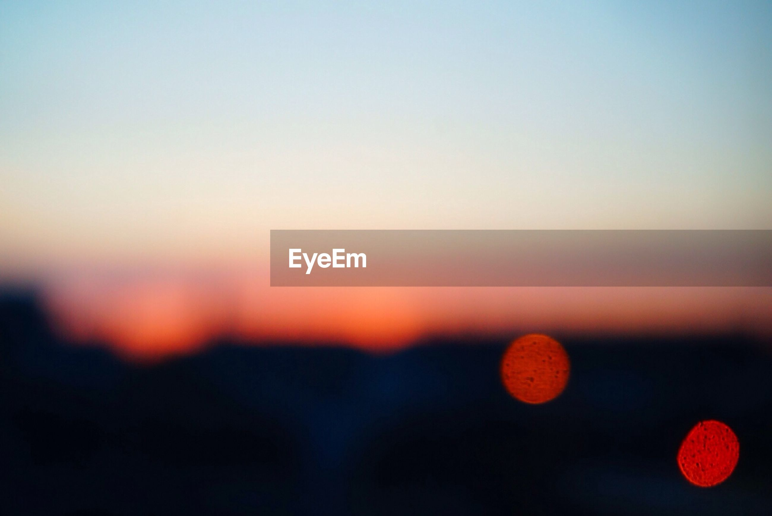 sunset, orange color, scenics, tranquil scene, beauty in nature, tranquility, copy space, clear sky, nature, red, idyllic, sky, focus on foreground, sun, landscape, dusk, no people, outdoors, silhouette, close-up
