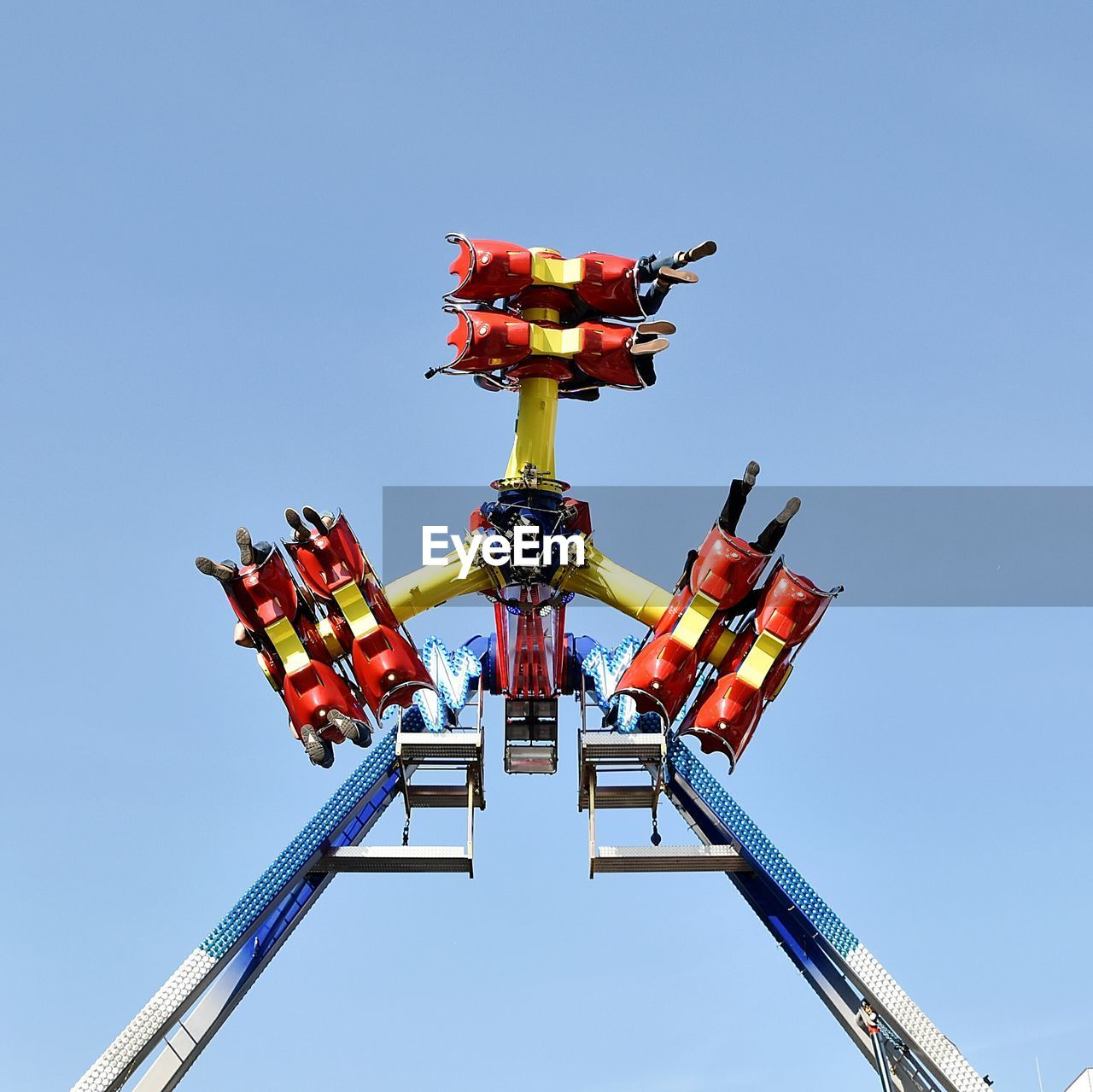 Low Angle View Of Ride Against Blue Sky