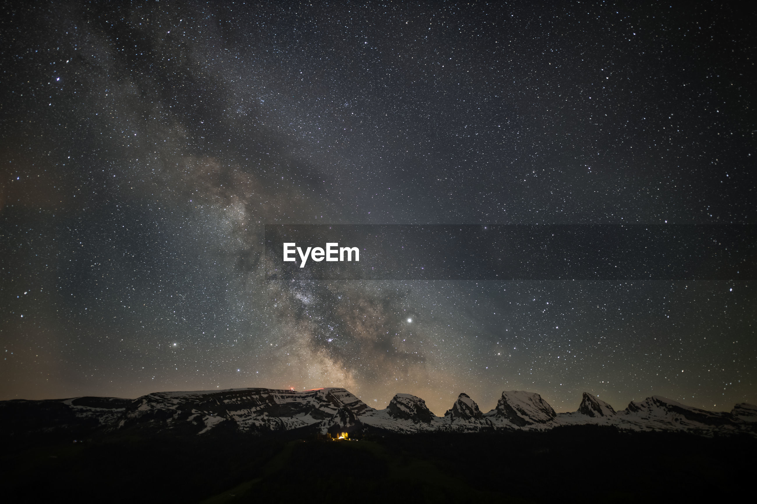 Scenic view of mountains against star field