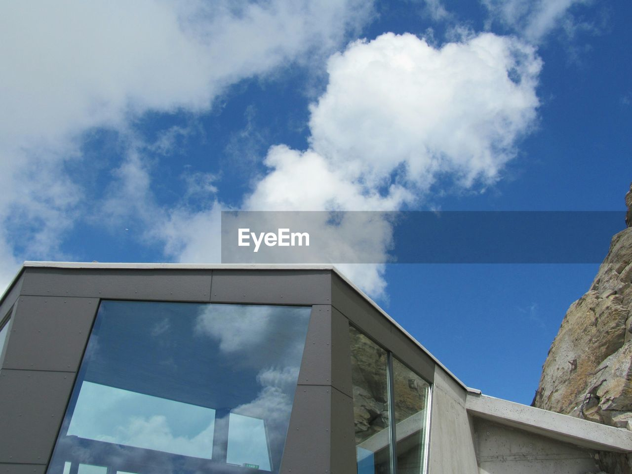 cloud - sky, sky, built structure, low angle view, architecture, day, building exterior, outdoors, blue, no people, nature