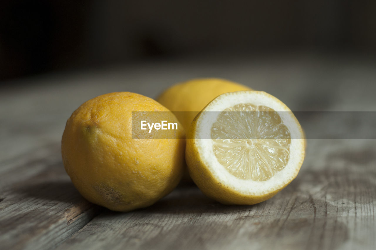 Close-up of lemons on table
