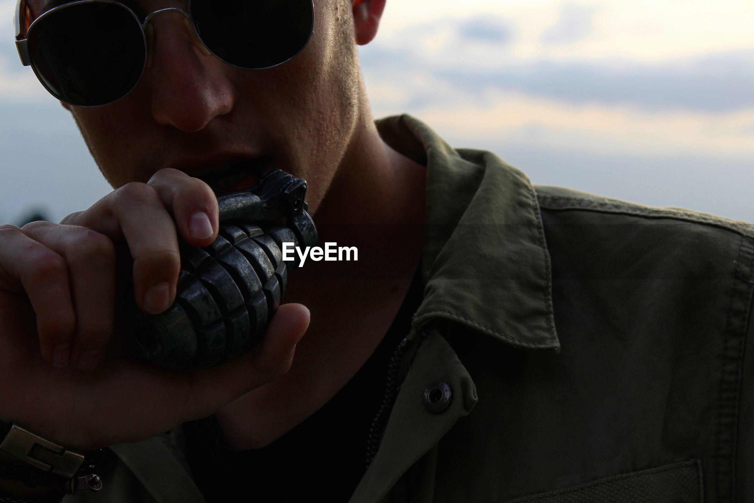 Close-up of man holding grenade