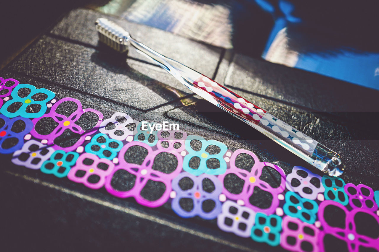 close-up, multi colored, no people, selective focus, still life, high angle view, indoors, table, pattern, scissors, metal, art and craft, pink color, man made, paper, writing instrument, day, man made object, equipment, steel