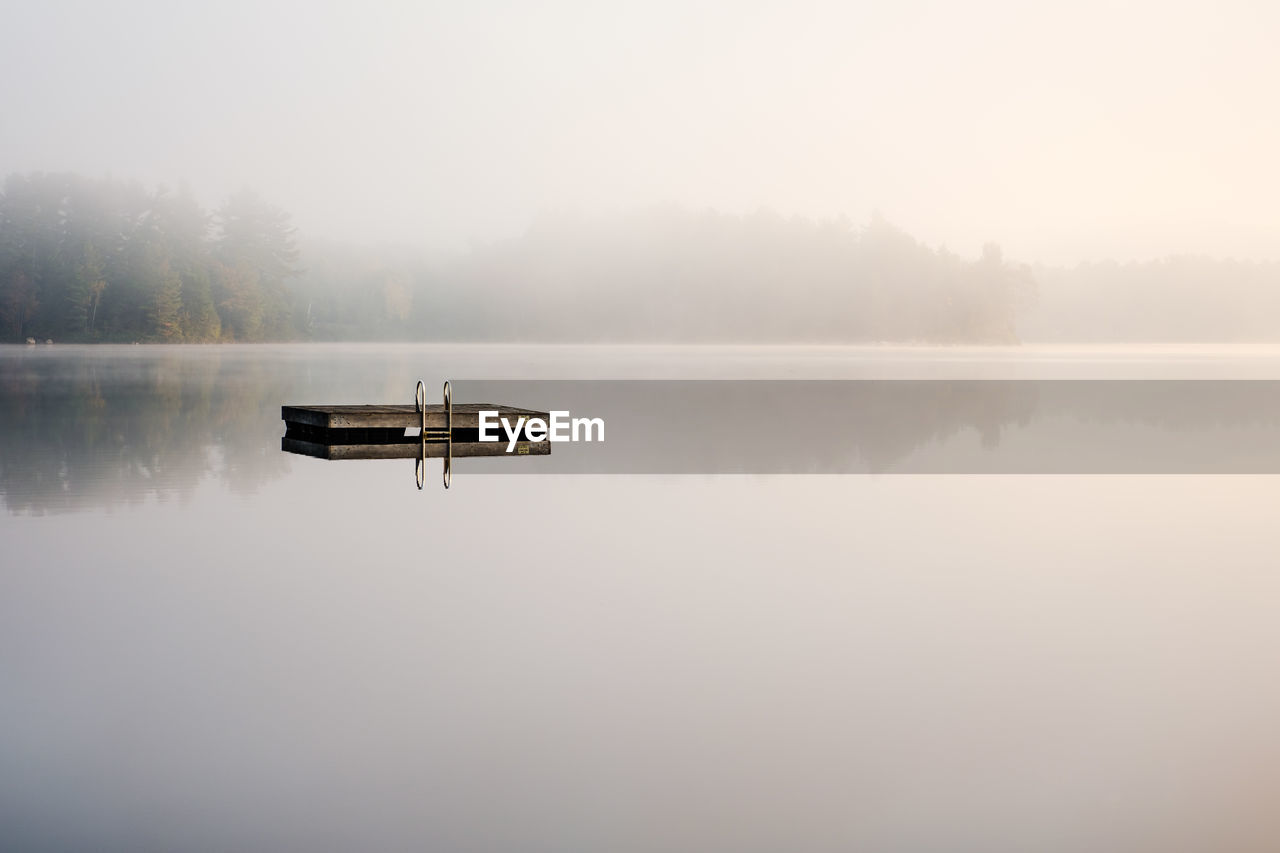 water, tranquility, lake, scenics - nature, tranquil scene, fog, reflection, beauty in nature, waterfront, sky, idyllic, non-urban scene, nature, no people, copy space, day, standing water, tree, outdoors, hazy, reflection lake