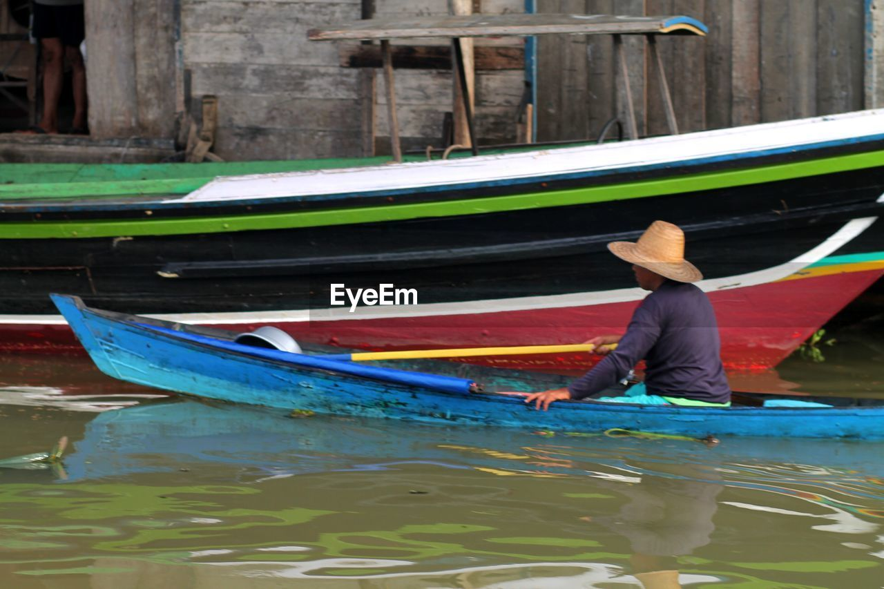 water, nautical vessel, transportation, mode of transportation, oar, one person, waterfront, day, real people, men, nature, gondola - traditional boat, occupation, paddling, reflection, canoe, outdoors, holding, rowing, canal, rowboat