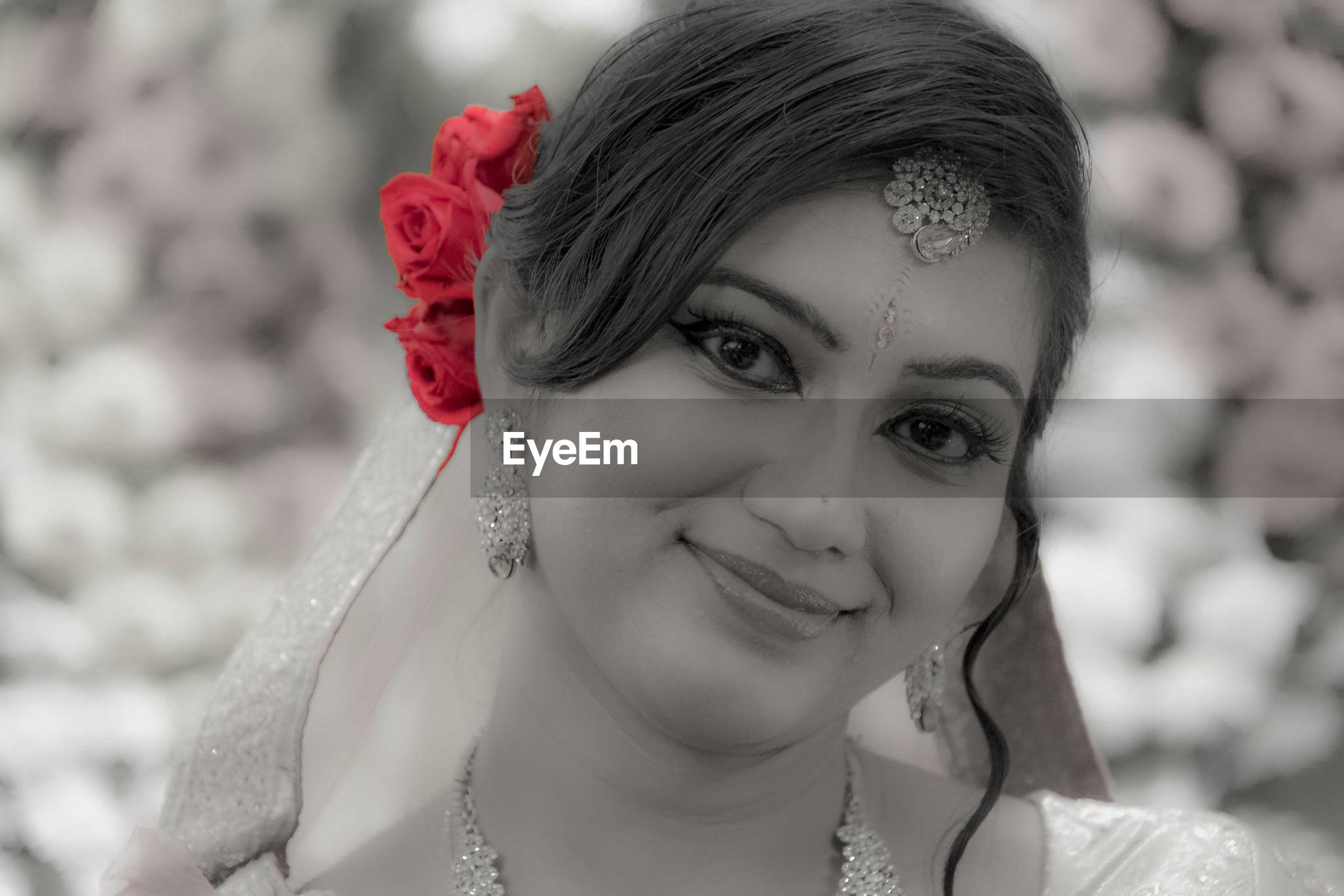 Close-up portrait of bride smiling