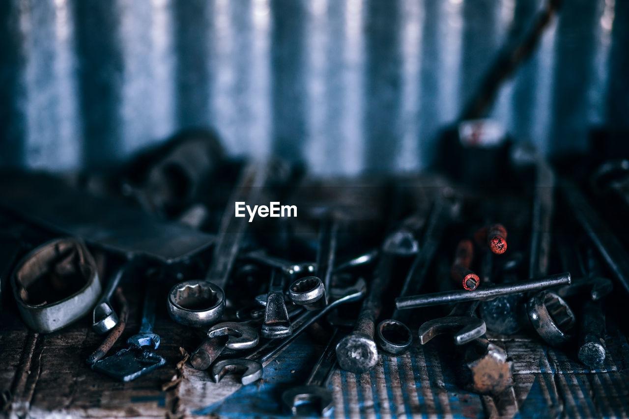 Close-Up Of Metallic Tools At Workshop
