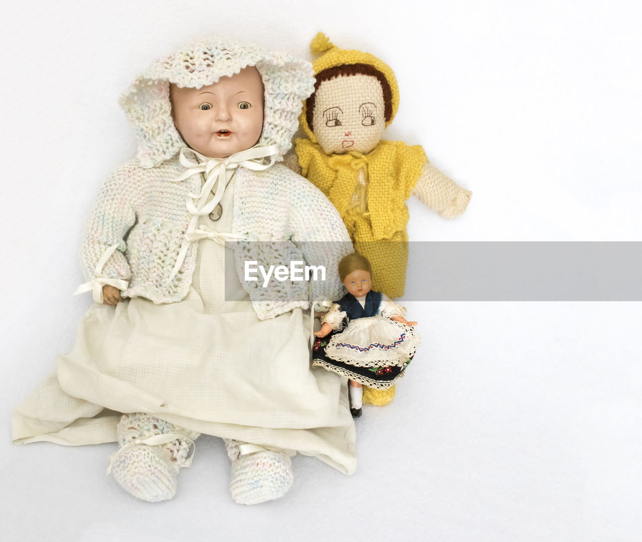 High angle view of dolls on white background