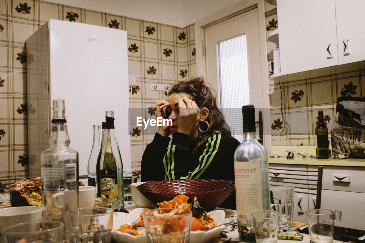 food and drink, food, drink, kitchen, indoors, domestic room, refreshment, one person, alcohol, domestic kitchen, bottle, waist up, home, lifestyles, wine, adult, glass, table, front view, meal, breakfast, dinner