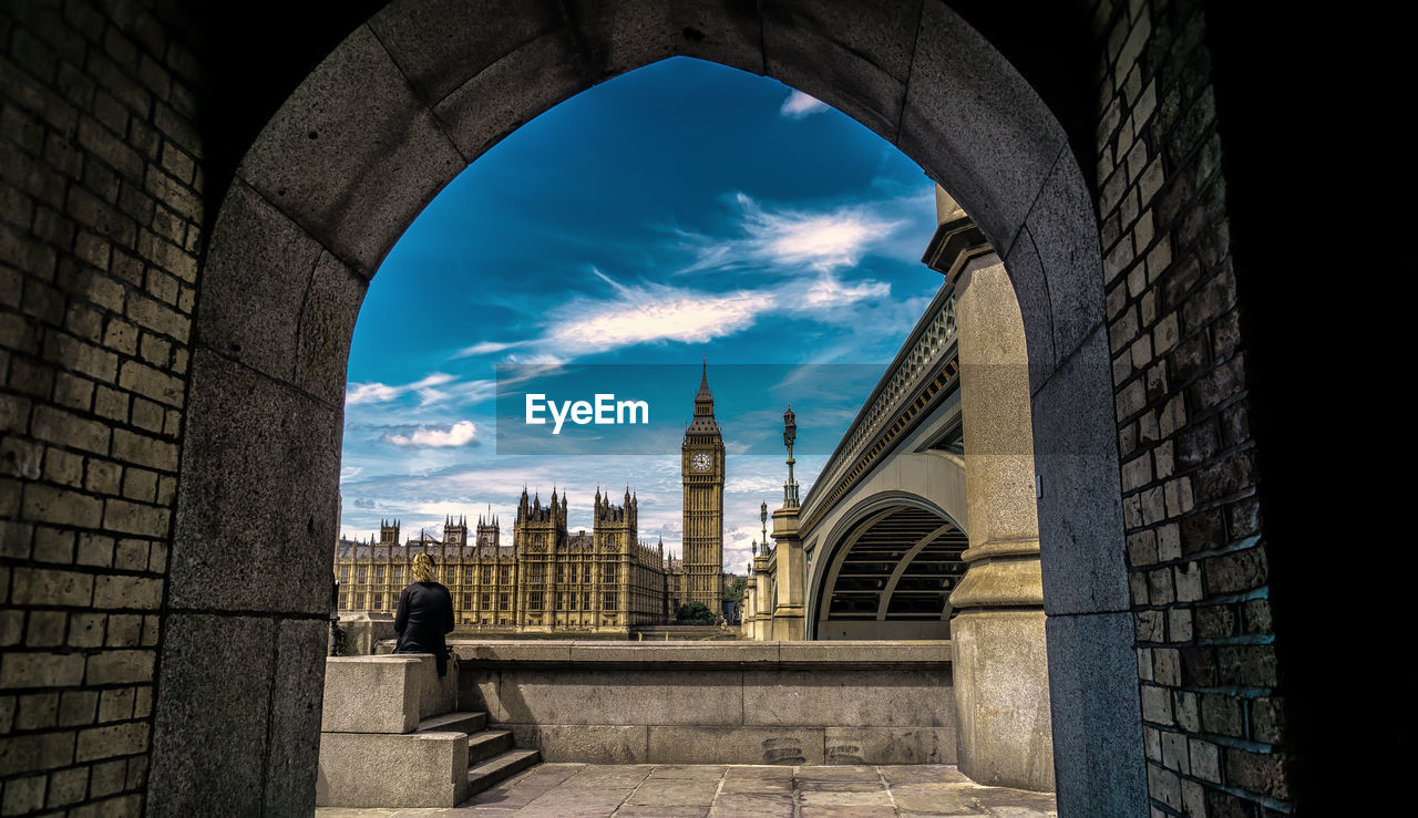 Historic big ben against sky seen from archway