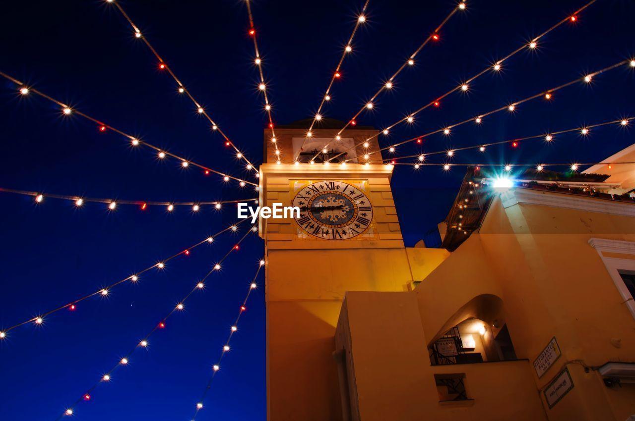 Low angle view of lighting decorations on capri christian church