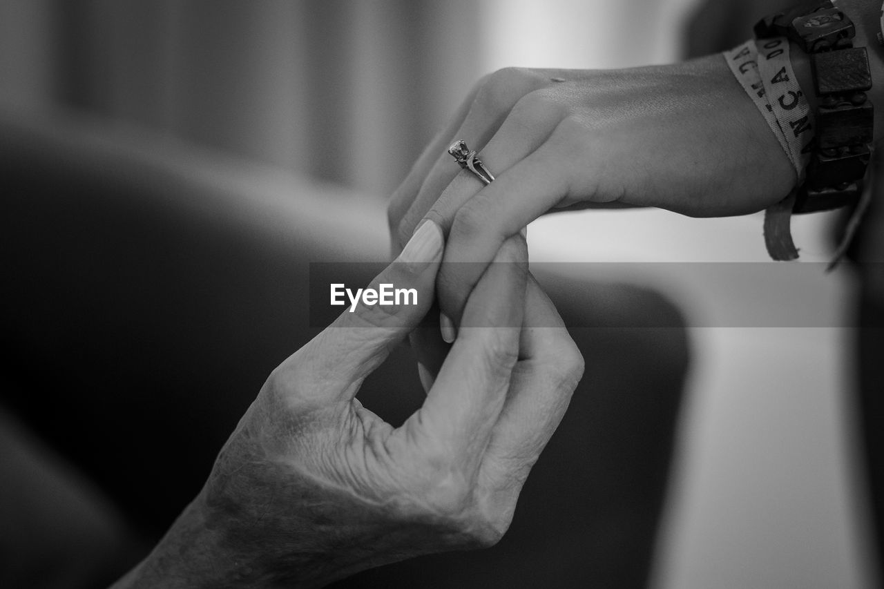 human hand, real people, human body part, wedding, love, men, two people, bride, focus on foreground, togetherness, women, couple - relationship, celebration, close-up, life events, finger ring, ceremony, groom, bridegroom, bonding, indoors, day, people