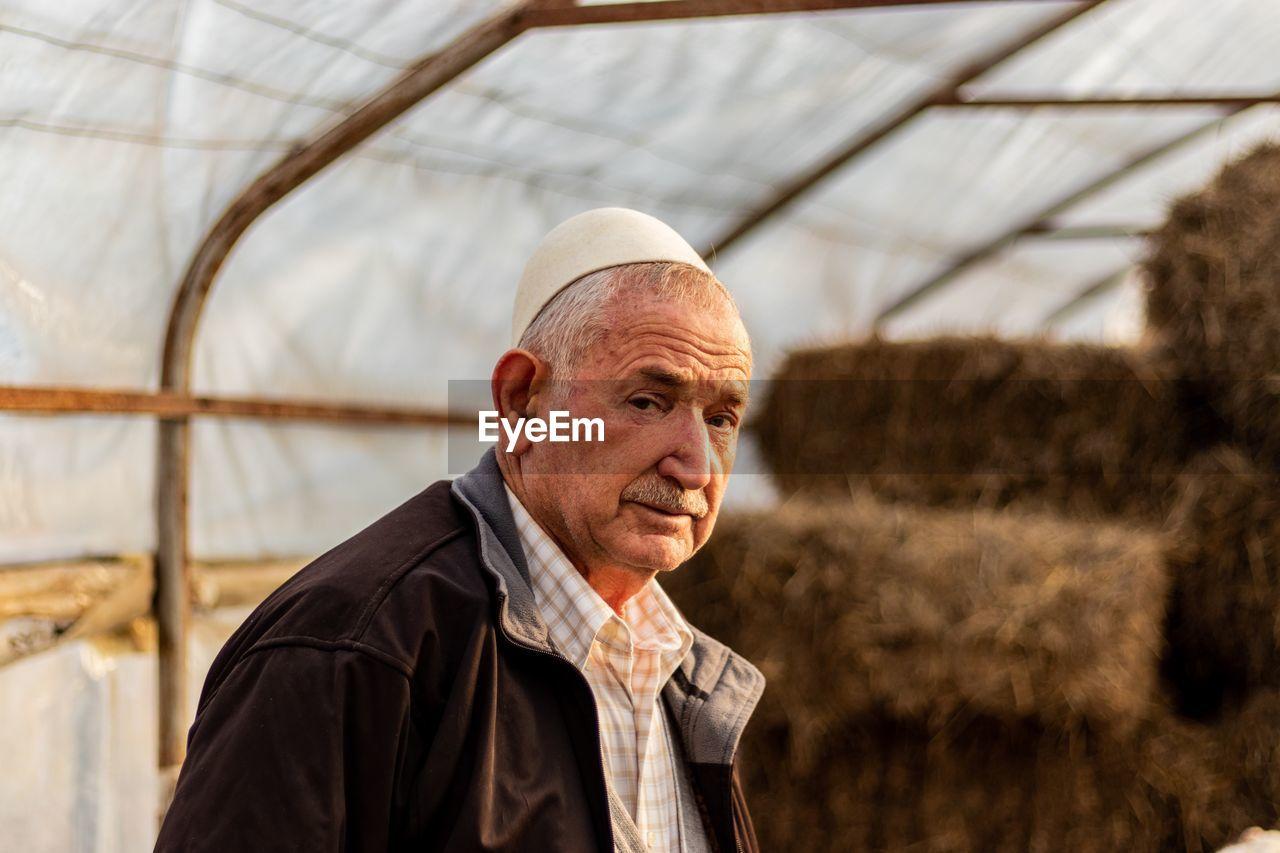 Portrait of man in greenhouse
