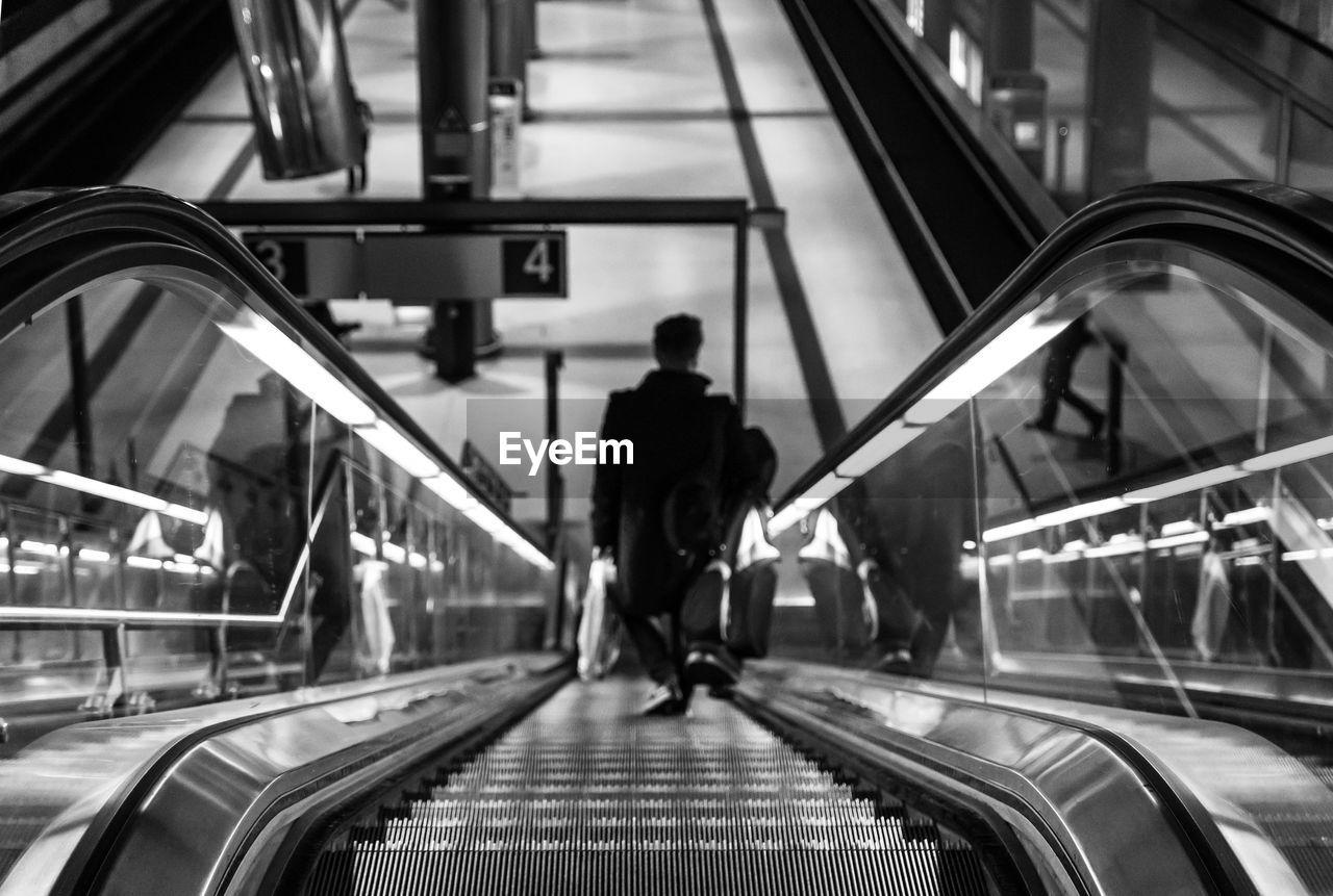 High angle view man on escalator