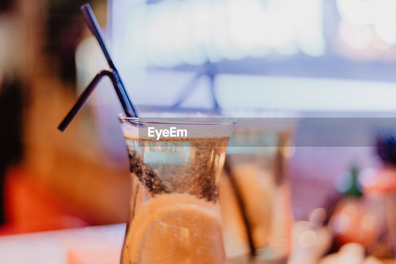 drink, refreshment, food and drink, table, close-up, focus on foreground, glass - material, glass, freshness, household equipment, transparent, drinking straw, drinking glass, straw, still life, no people, alcohol, business, cold temperature, indoors, non-alcoholic beverage, temptation