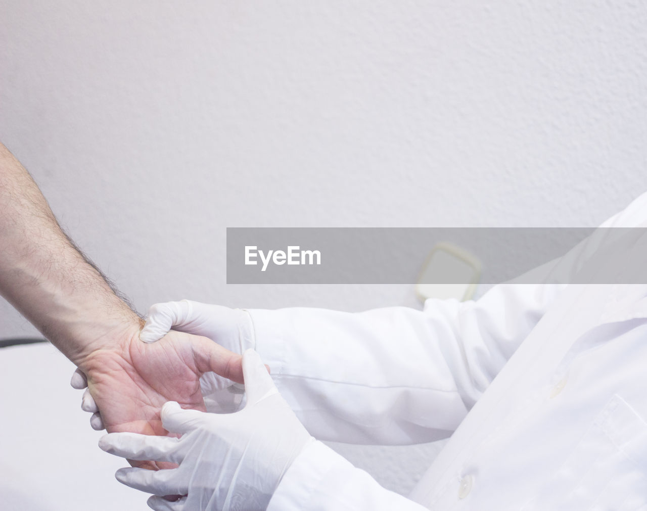 hand, human hand, human body part, men, real people, healthcare and medicine, two people, hospital, indoors, people, occupation, white color, copy space, patient, adult, midsection, lab coat, doctor, togetherness, clothing, human limb, responsibility
