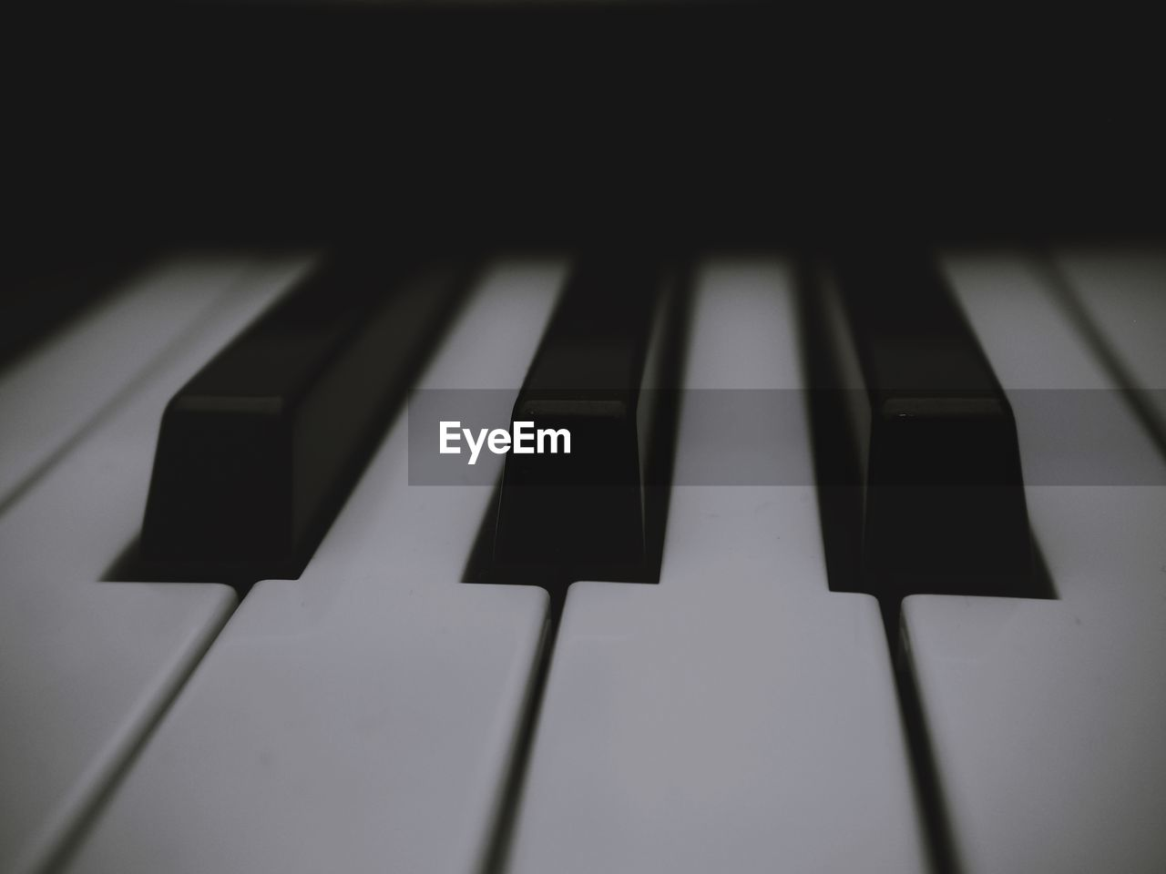 musical equipment, music, musical instrument, piano, piano key, arts culture and entertainment, close-up, no people, indoors, black color, white color, keyboard instrument, full frame, backgrounds, keyboard, pattern, high angle view, focus on foreground, selective focus, shadow