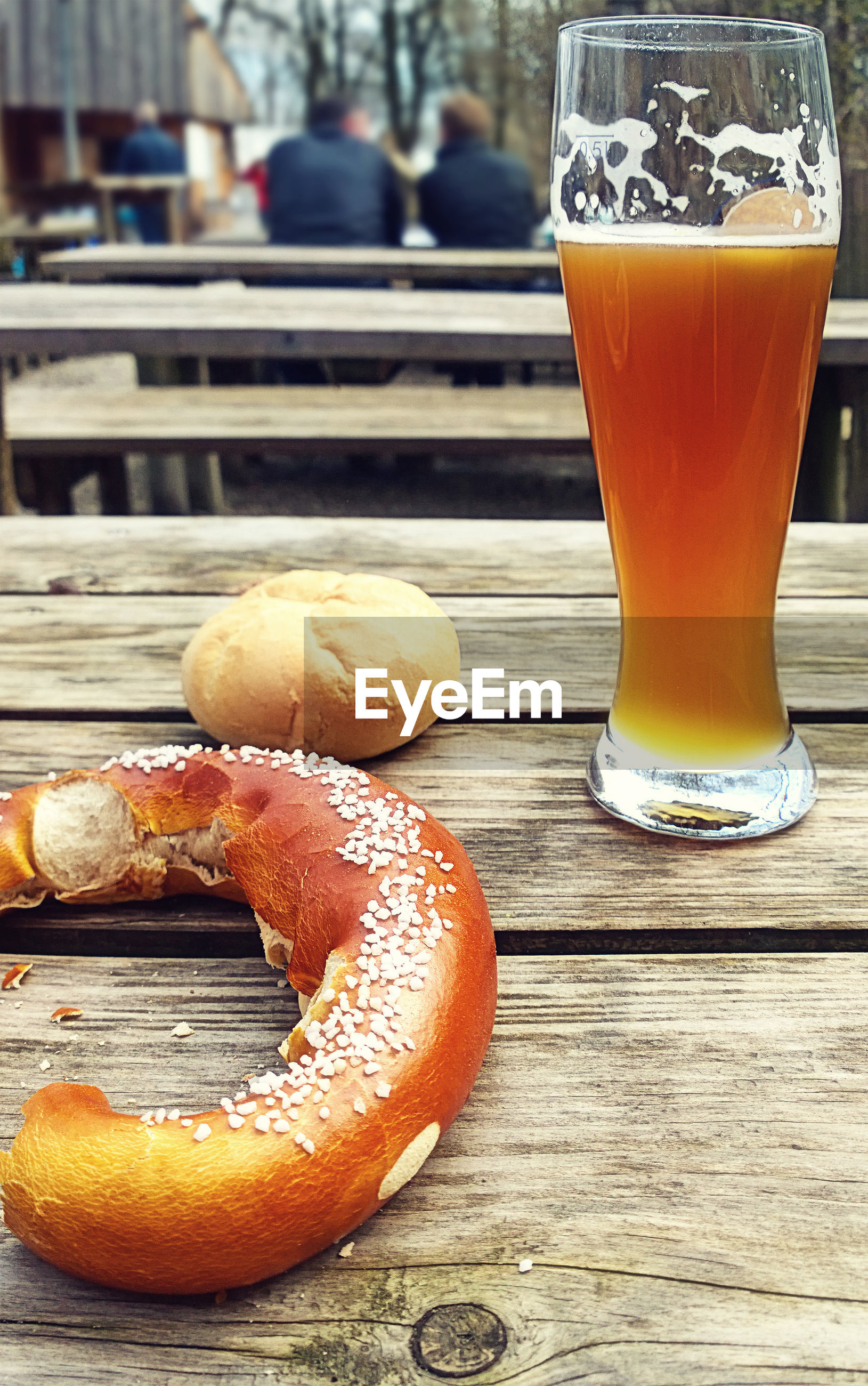 food and drink, drink, freshness, table, refreshment, food, glass, beer, still life, drinking glass, beer glass, focus on foreground, wood - material, beer - alcohol, close-up, household equipment, incidental people, orange color, ready-to-eat, snack, breakfast, temptation