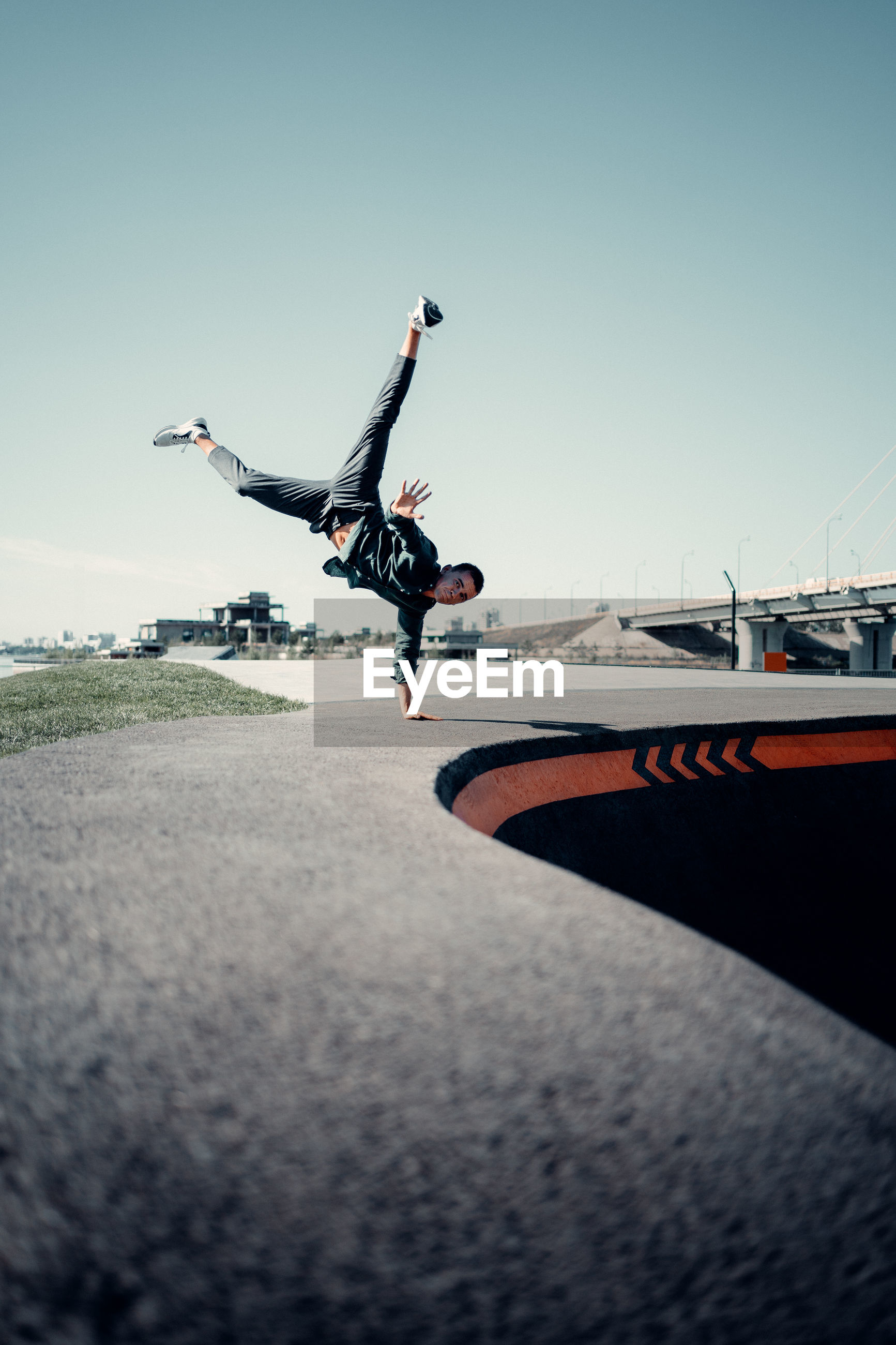 LOW ANGLE VIEW OF MAN JUMPING AT AIRPORT