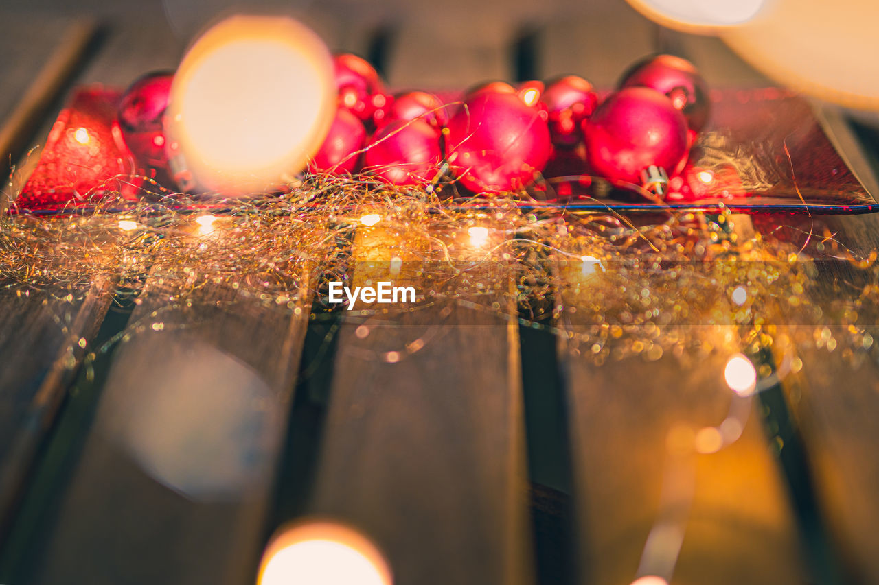 illuminated, selective focus, red, food and drink, close-up, no people, indoors, fruit, food, glowing, healthy eating, decoration, lighting equipment, burning, still life, freshness, candle, christmas lights, celebration, christmas decoration, christmas ornament