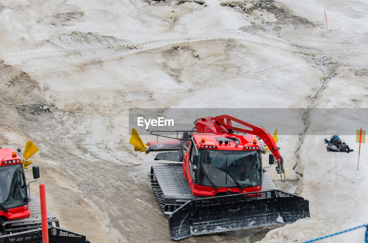 High Angle View Of Construction Vehicles On Ground