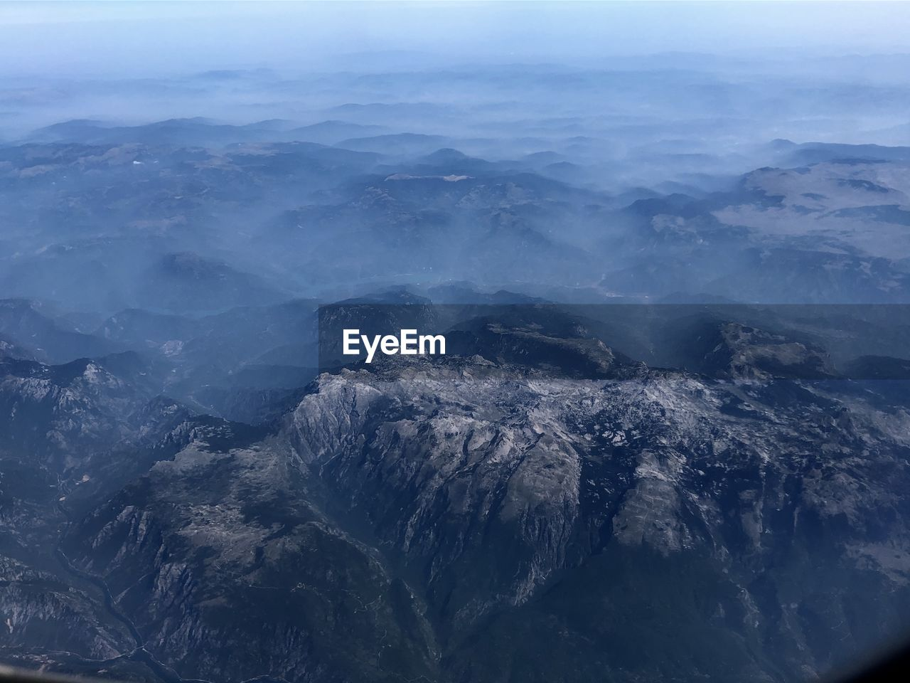 High angle view of rocky mountains against sky