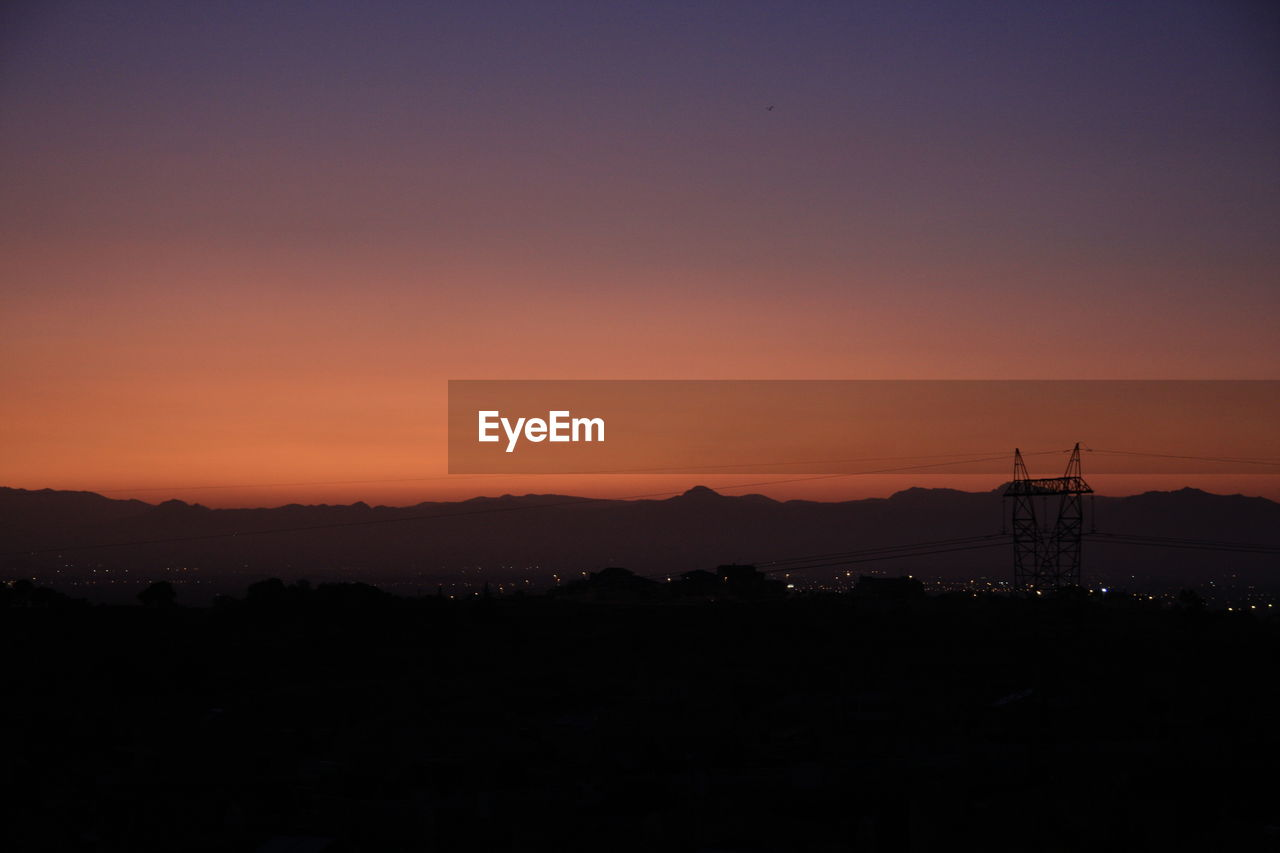 sky, sunset, silhouette, copy space, beauty in nature, scenics - nature, orange color, tranquil scene, no people, environment, nature, tranquility, idyllic, architecture, built structure, landscape, outdoors, land, non-urban scene, building exterior