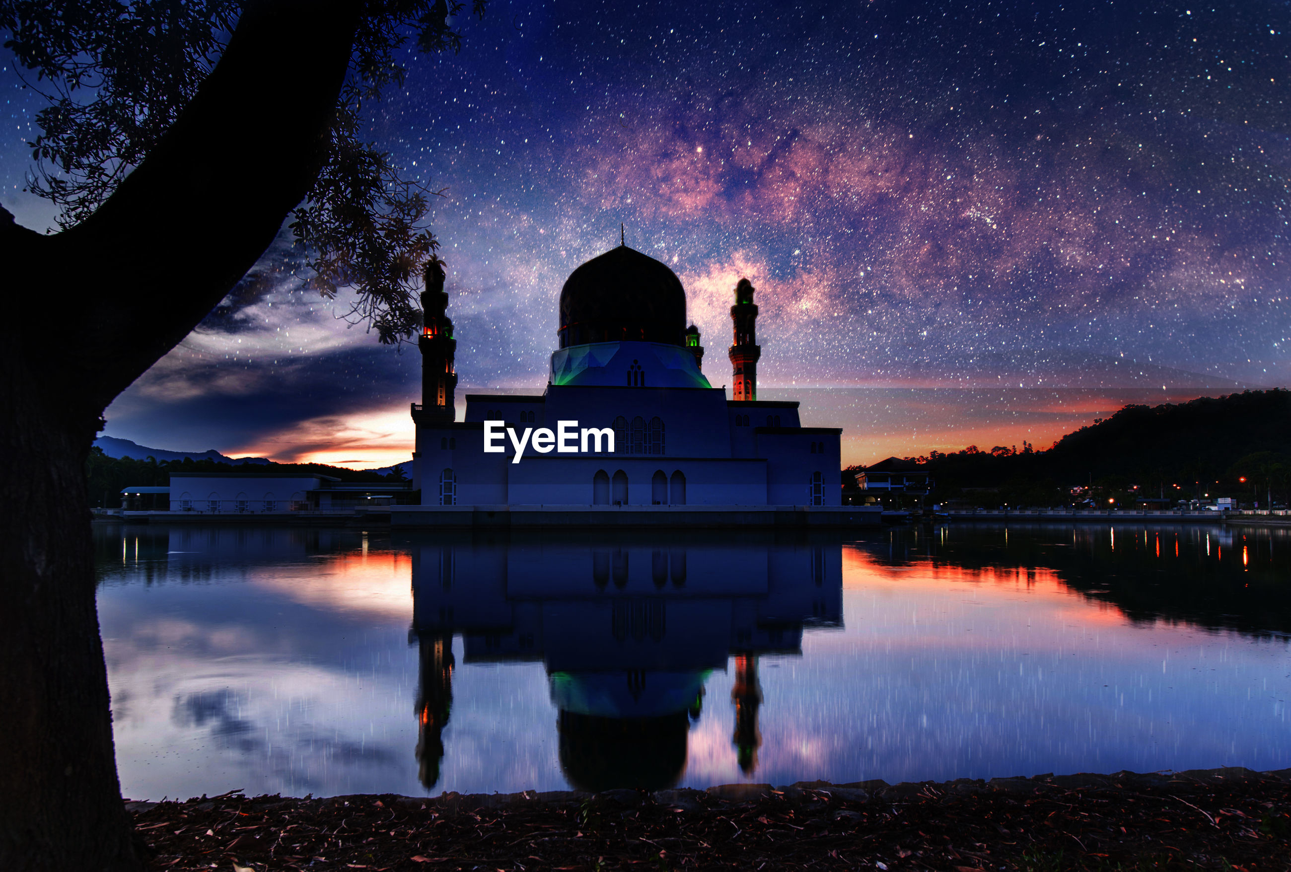 Floating mosque with milky way and reflection