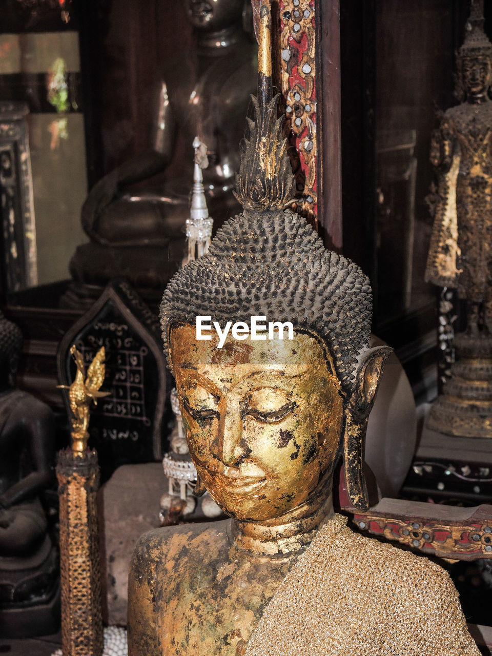 religion, statue, art and craft, spirituality, sculpture, human representation, indoors, no people, focus on foreground, place of worship, antique, gold colored, close-up, day