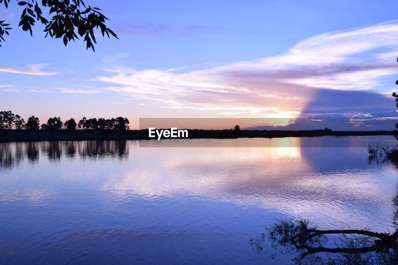 water, reflection, sky, tree, beauty in nature, nature, scenics, tranquil scene, sunset, silhouette, tranquility, cloud - sky, outdoors, lake, waterfront, no people, day