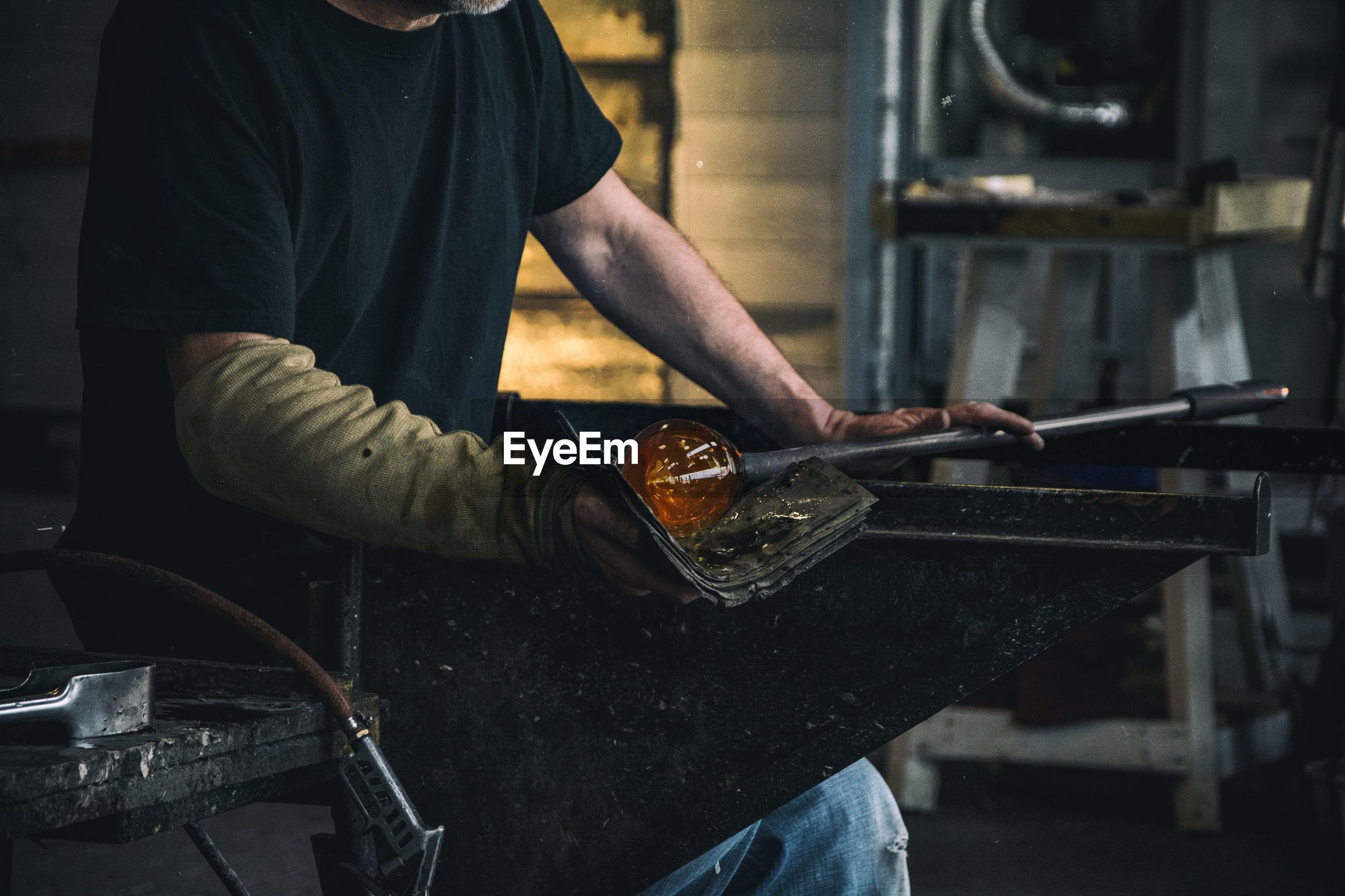 Man working on glassware