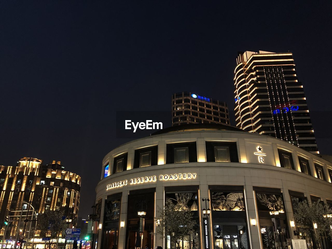 building exterior, architecture, night, built structure, illuminated, city, sky, building, low angle view, modern, nature, office building exterior, copy space, clear sky, travel destinations, tall - high, no people, skyscraper, office, luxury, nightlife