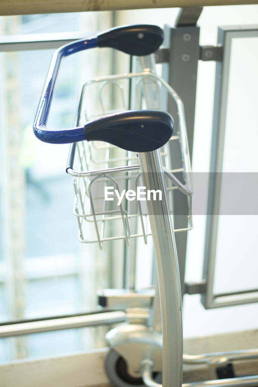 metal, indoors, focus on foreground, no people, close-up, day, window, healthcare and medicine, hospital, seat, empty, equipment, low angle view, chair, built structure, absence, gym, handle, medical equipment